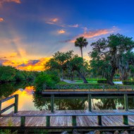 Sunset over St. Lucie River at White City Park in Fort Pierce, Florida. HDR photo created in Photomatix Pro and Topaz software.