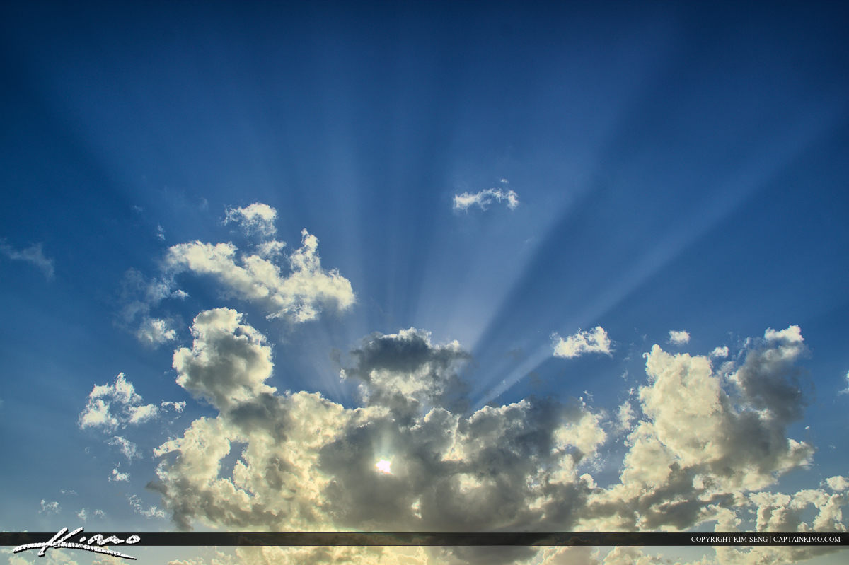 Sunray from Heaven Through Cloud in Sky