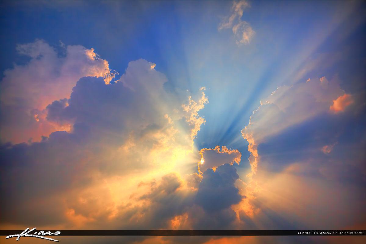Light Bursting from CloudsSunrays Beam of Light Clouds
