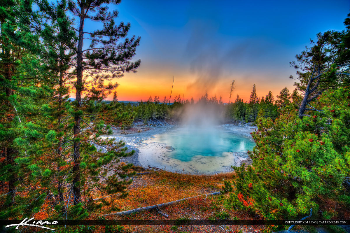 Geyser at Yellowstone National Park During Colorful Sunset