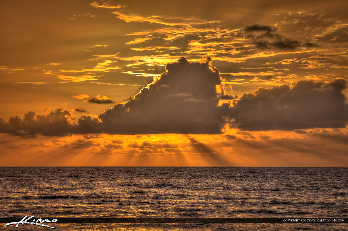 Rays of Hope Over Ocean in Florida Beach