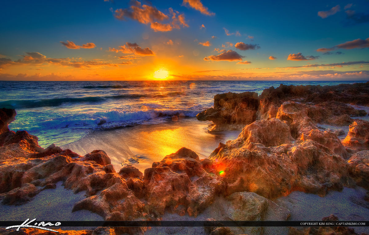 Sunrise at Beach in Hutchinson Island by Rocks