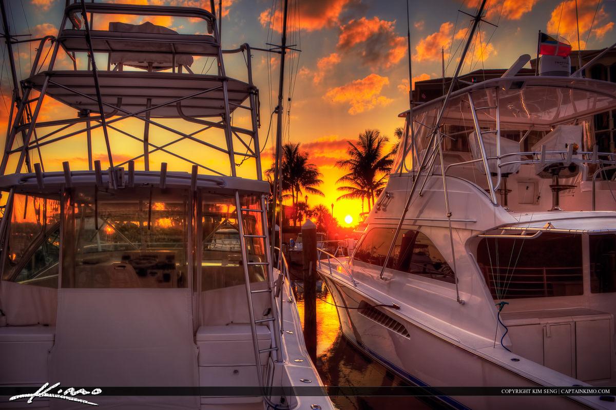 Sunset Between Two Yachts at Riverwalk Marina Jupiter Florida