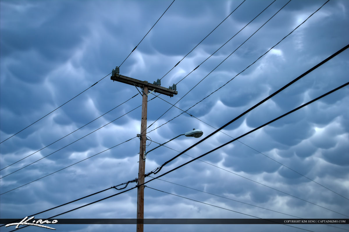 Telephone Pole and Electric Powerlines with Cloudy Storm Sky