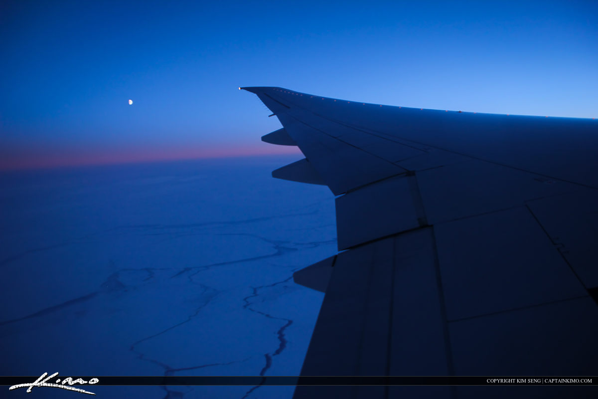 Moon Over the Artic from Airplane Window