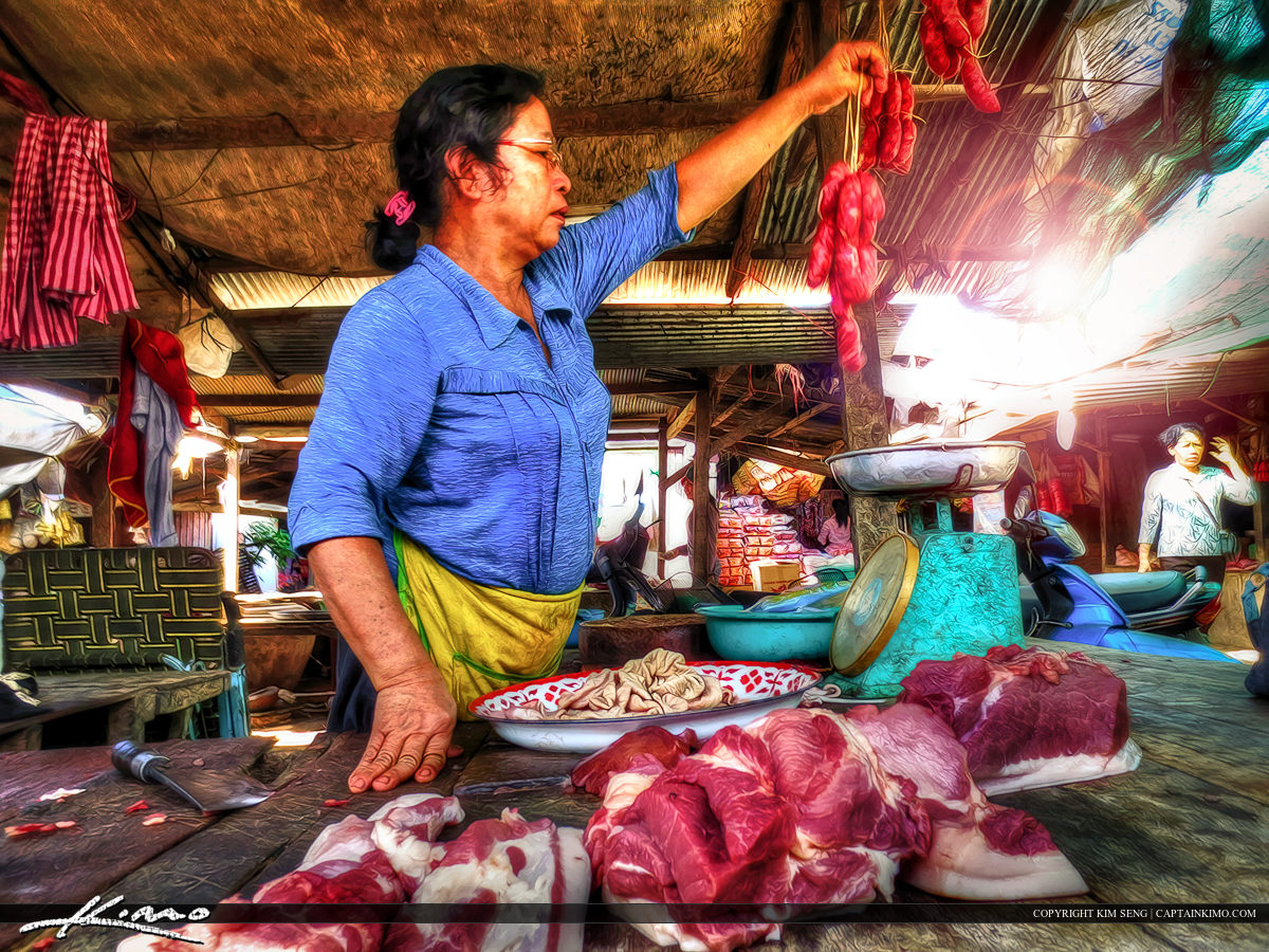 Getting Some Pork at the Market in Cambodia
