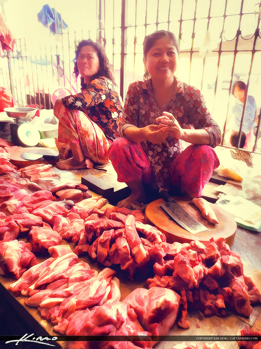 Cambodian Butcher Woman at the Market in Battambang Cambodia