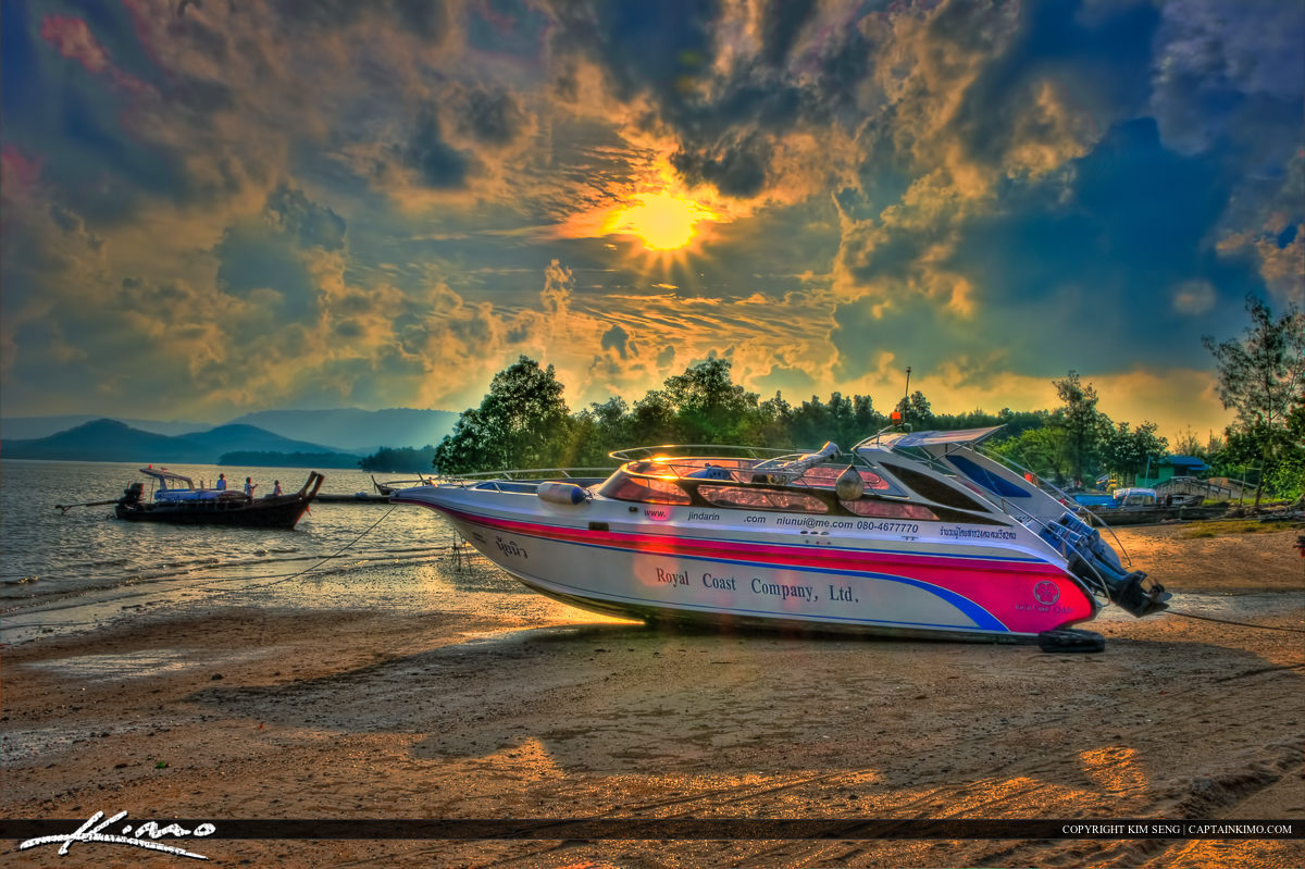Speed Boat at Low Tide Coconut Island Phuket Thailand