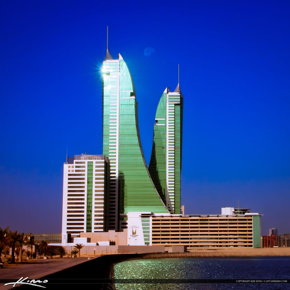 Bahrain Financial Harbour Twin Architectural Buildings at Moon Set