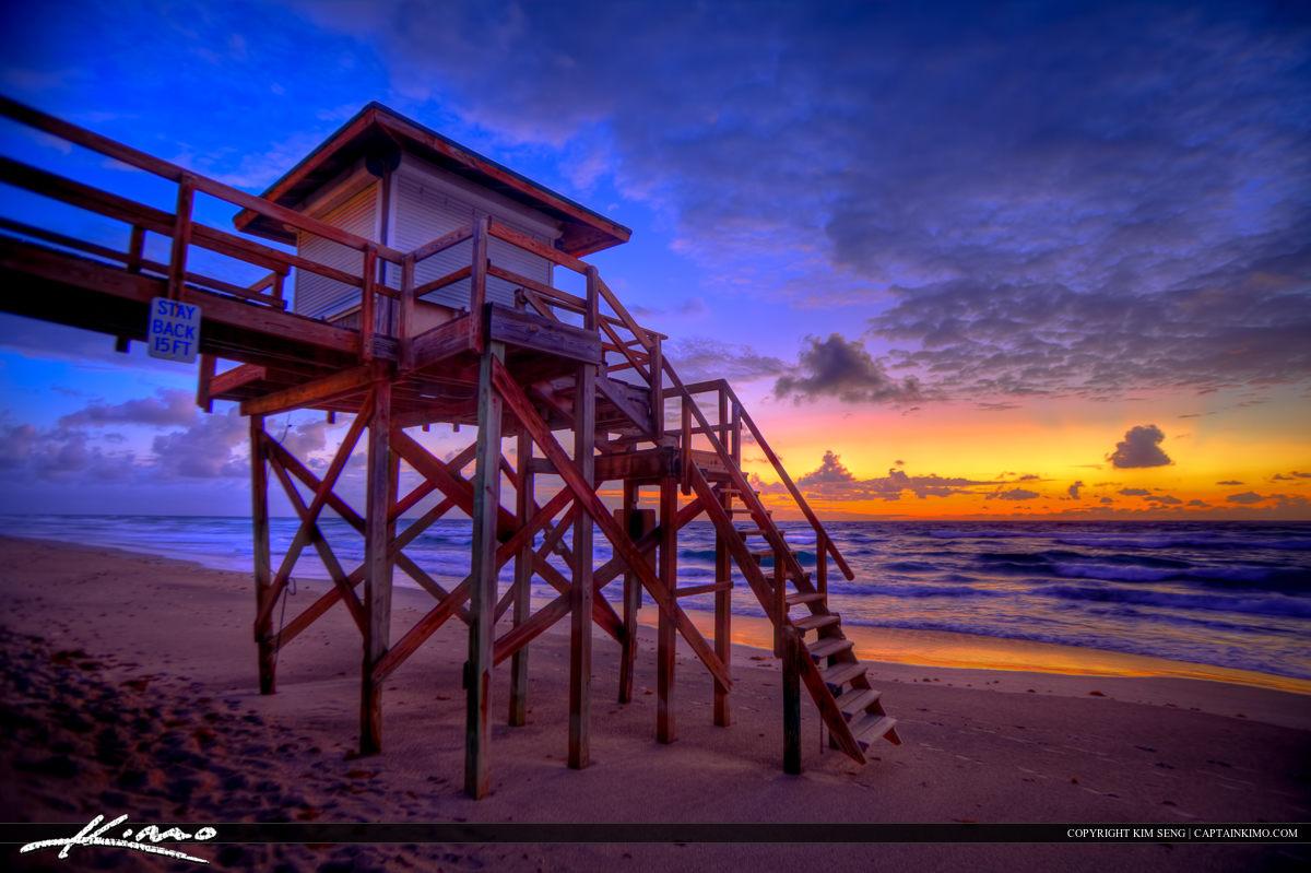 Sun Rising at Beach Over Lifeguard Tower