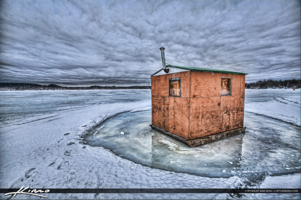 Ice Fishing on Frozen Lake from House Portland Maine