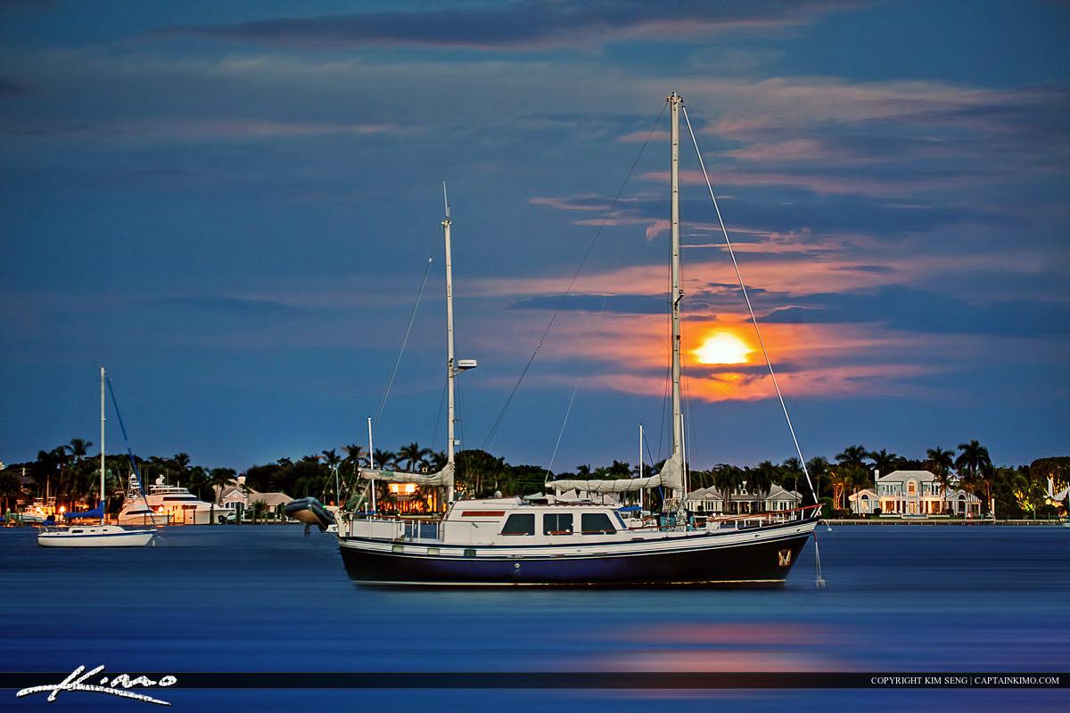 Sailboat Under Full Moon Light at Singer Island Florida