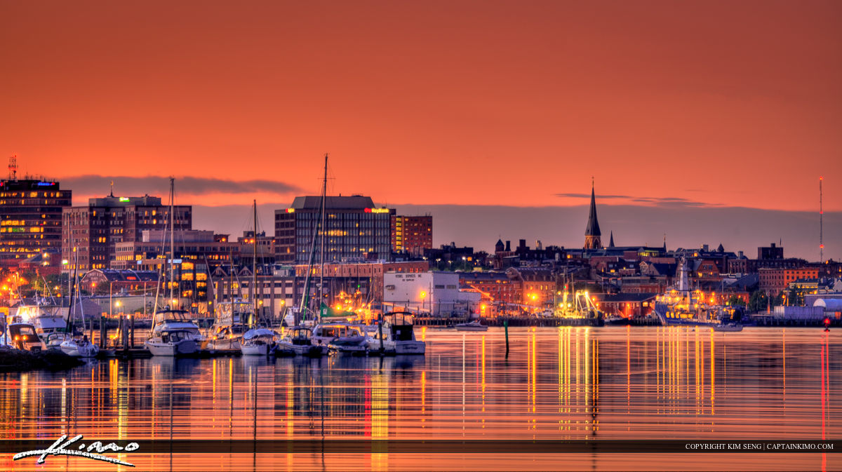 Portland Maine Downtown City Lights at Sunset Over Marina Boat Yard