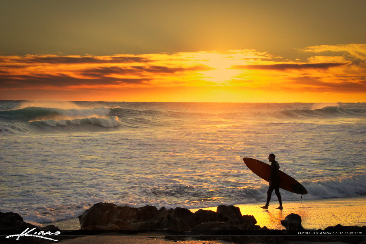 Surfer with Surfboard at Beach During Sunrise Florida