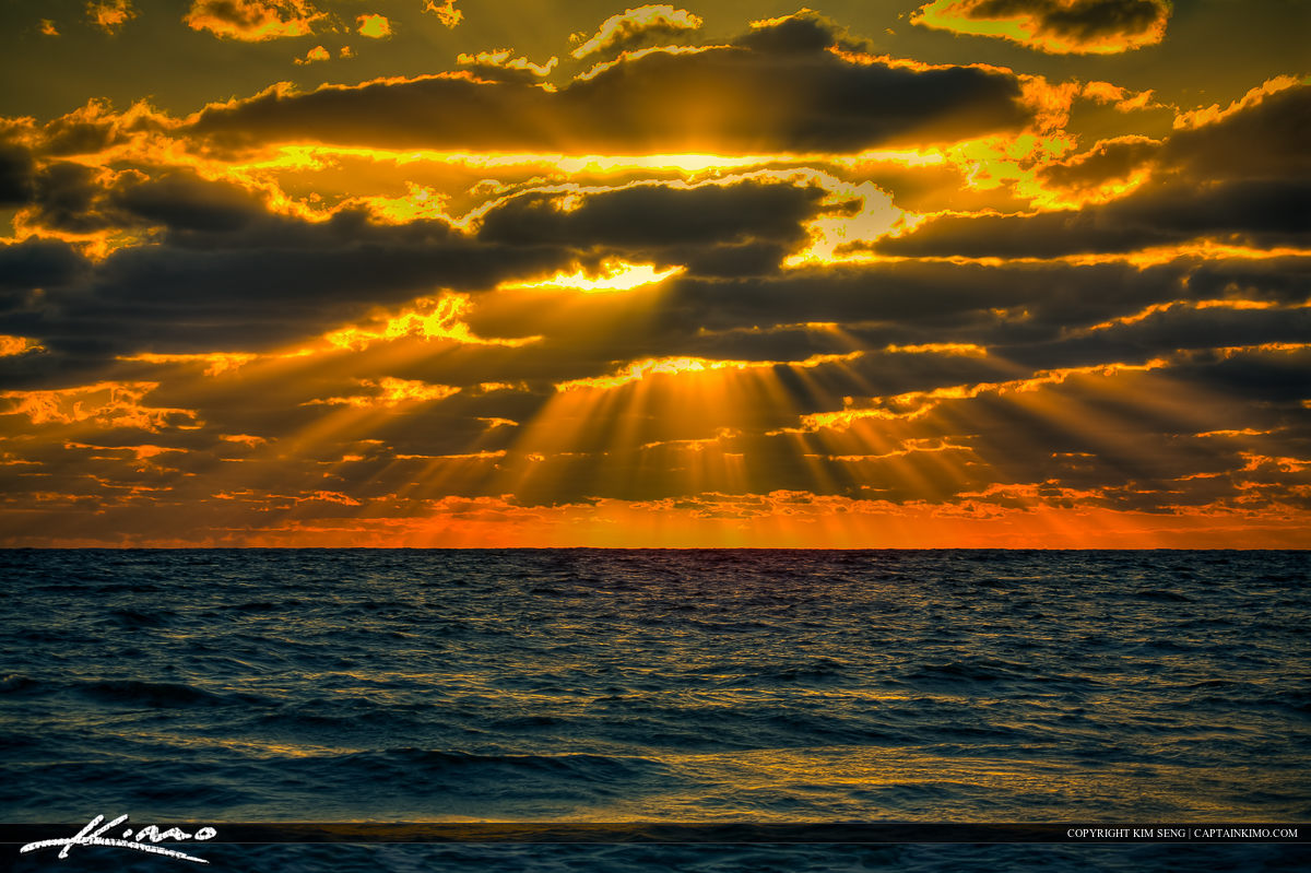 Sunrise Over Atlantic Ocean with Sunrays