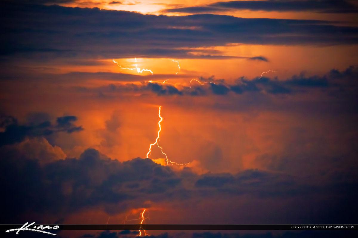 Lightning Bolt in Sky Bursting in Red Clouds