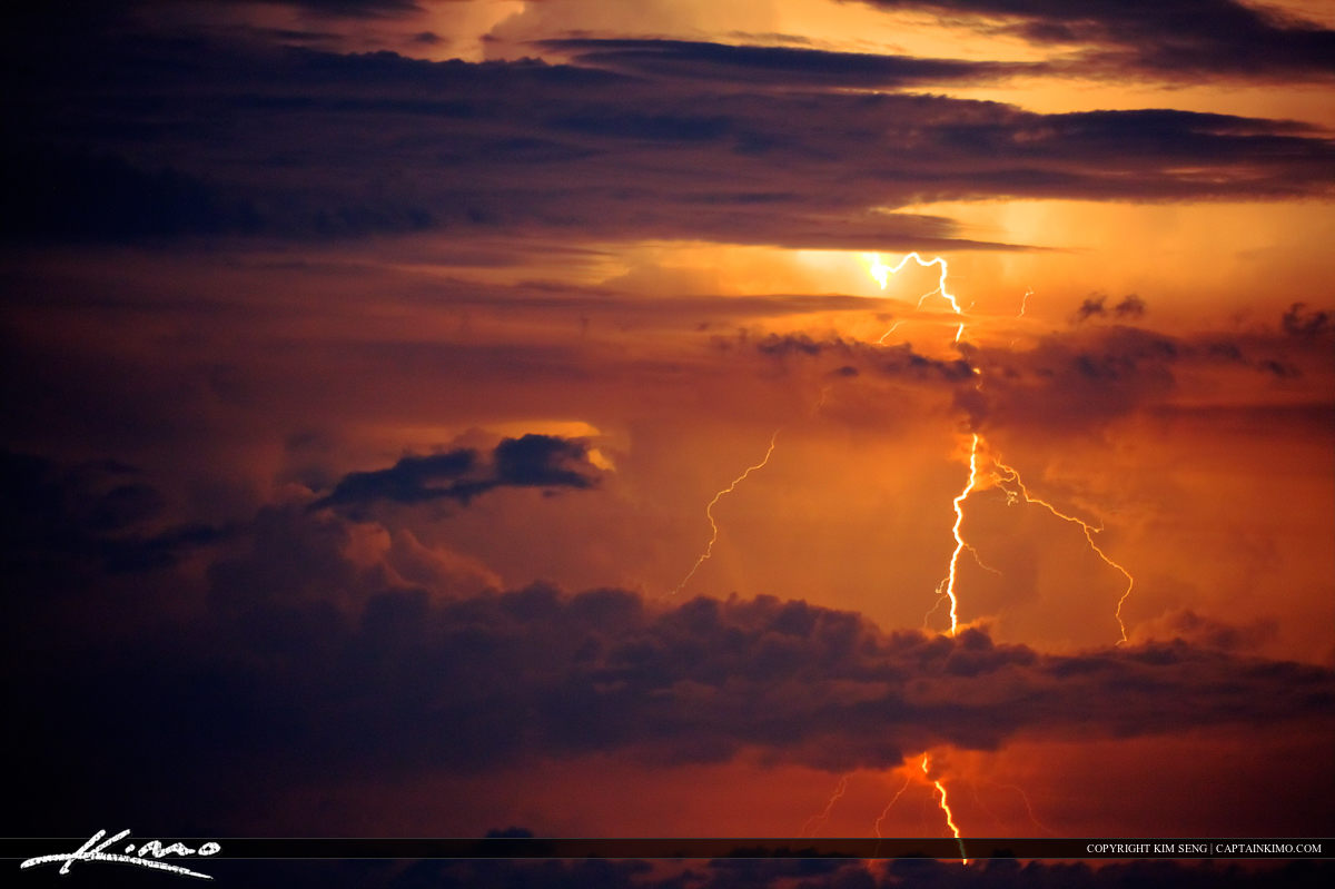 Heat Lighting Over Ocean Red Sky Burst of Energy