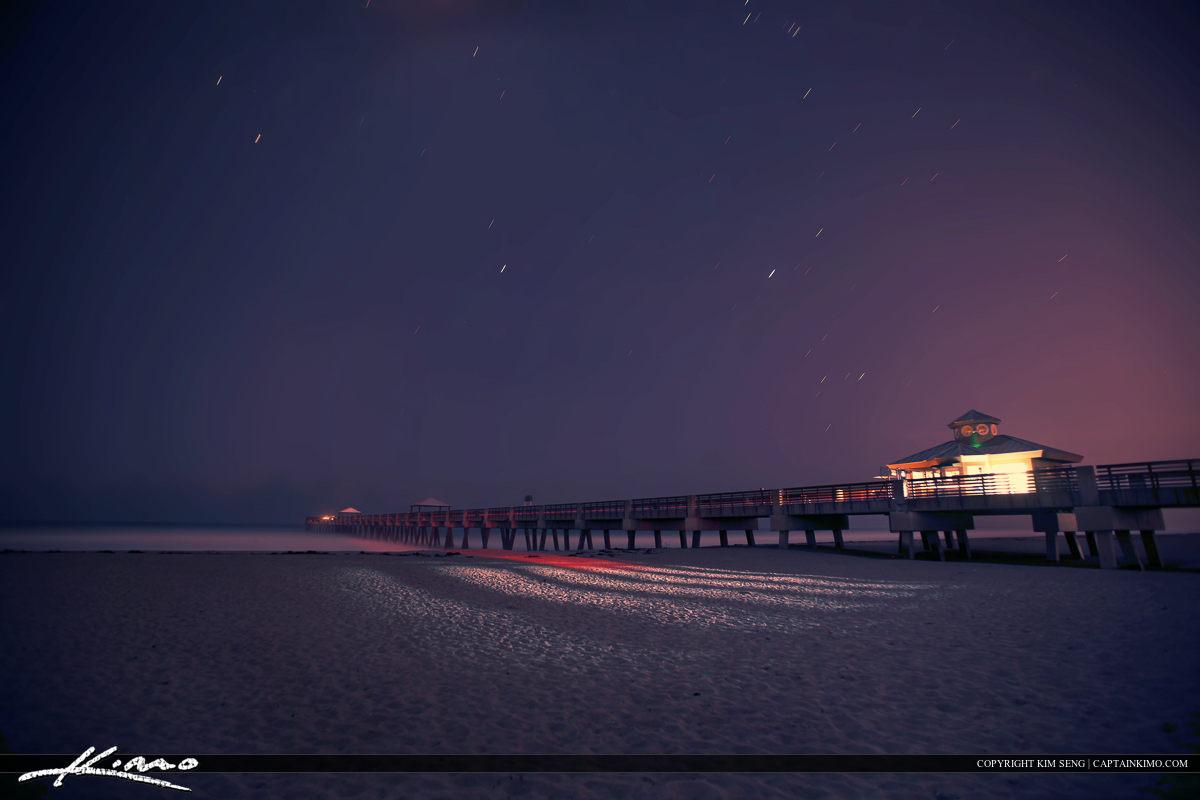 Juno Pier Nighttime Lights on Beach Stars in Motion