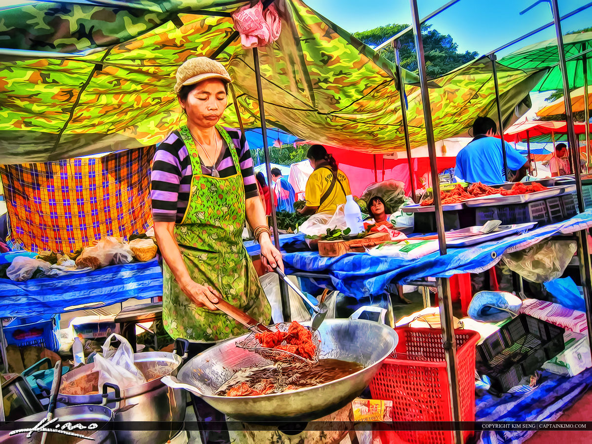 Woman Frying Fish in Country Market Thailand