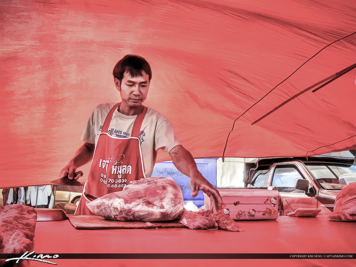 The Butcher in Thailand Cutting Meat for Customer