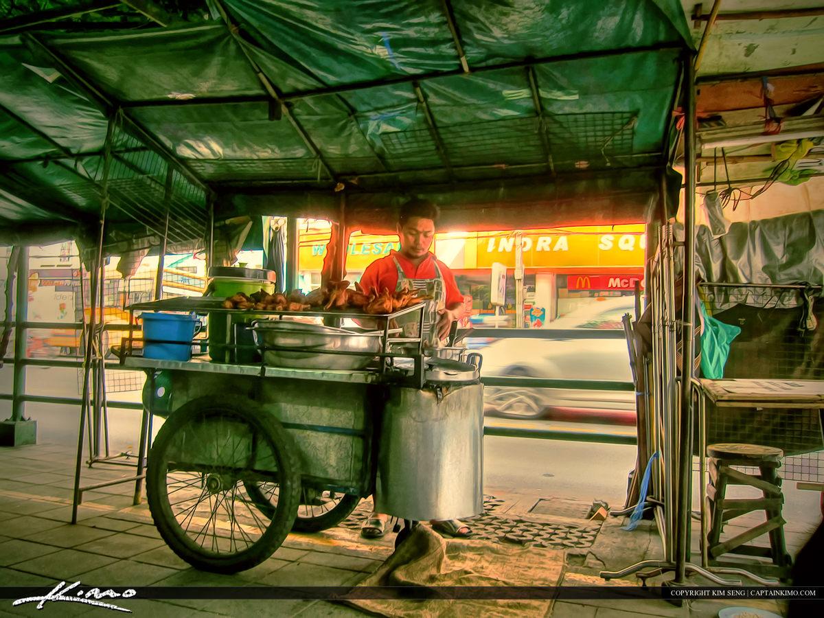 Man Selling Fried Chicken in Bangkok Thailand