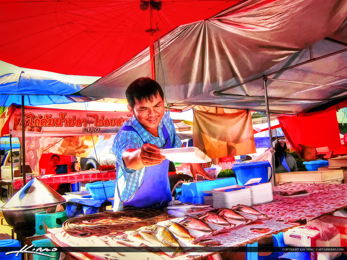 Man Selling Fish in Thailand Country Market