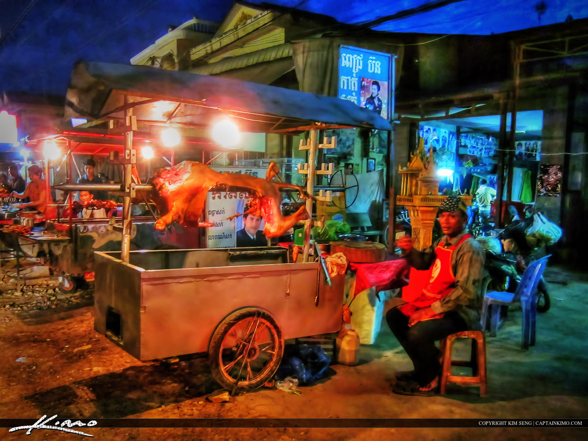 Man Selling Cow Meat Along the Road Cambodia