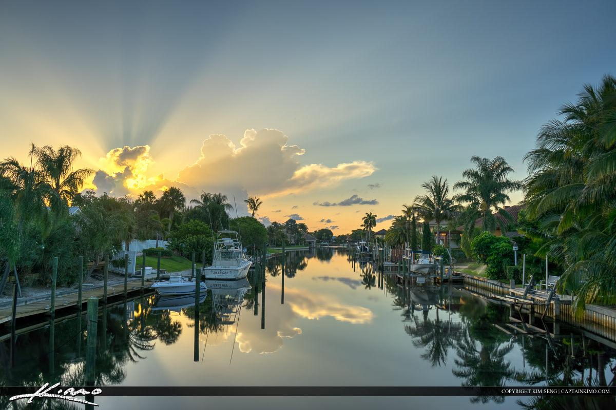 Sunrise with sunrays over cabana colony canal Palm Beach Gardens