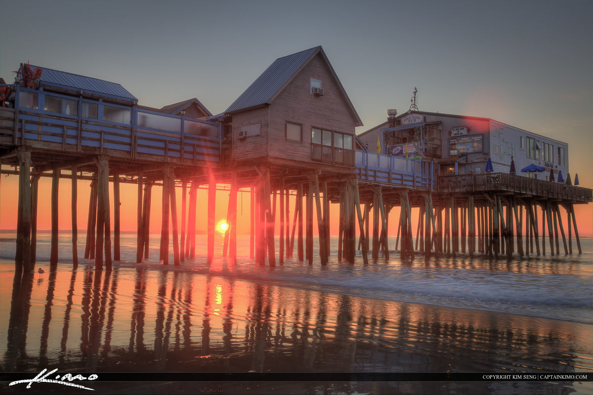 Sun underneath the pier at old Orchard Beach