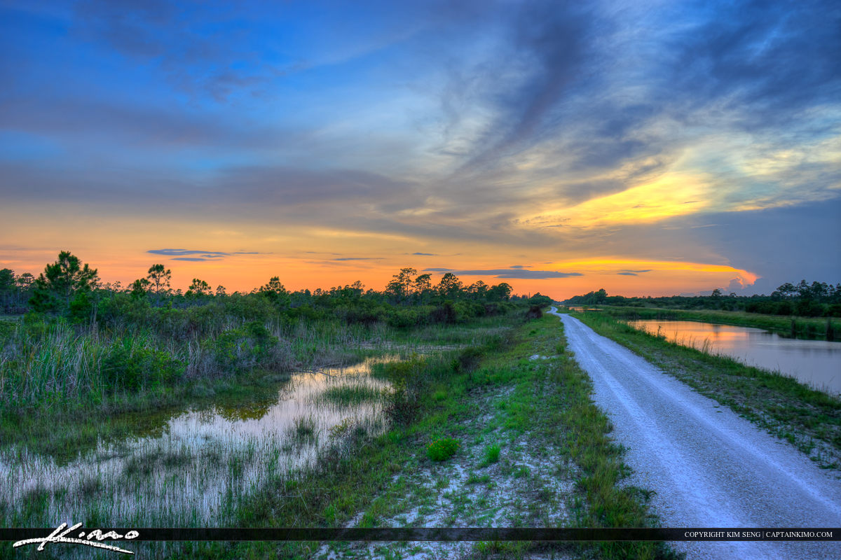 Hungry land wildlife management area sunset at road