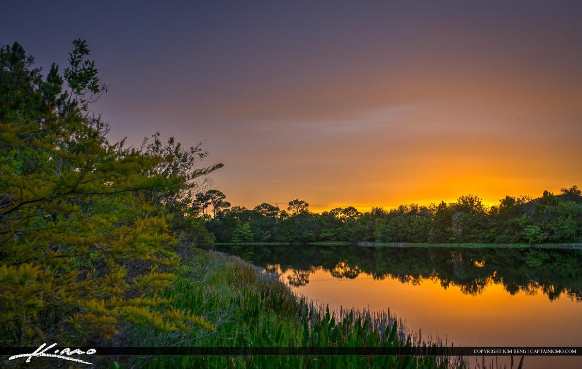 Warm Sunset Over Lake in Jupiter Neighborhood