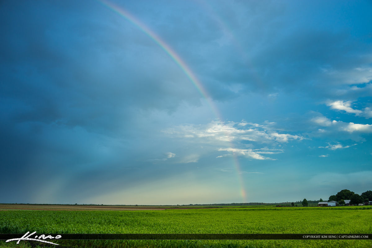 Rainbow over field at farm by Lake Placid