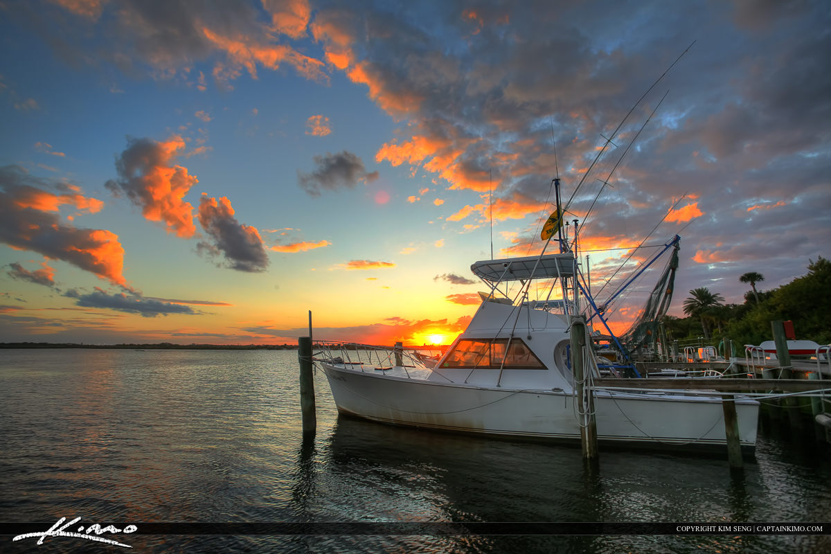 Ponce Inlet Marina Dock Fishing Boat During Sunset on Water