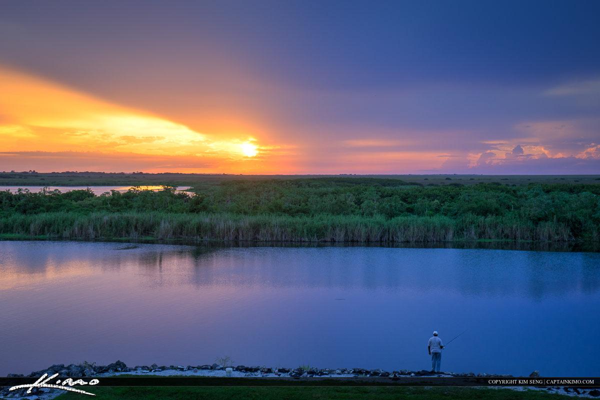 Man at Okeechobee Lake fishing during sunset