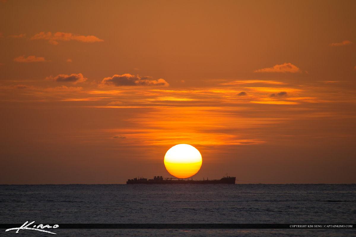 Cargo Ship Sunrise Over Atlantic Ocean