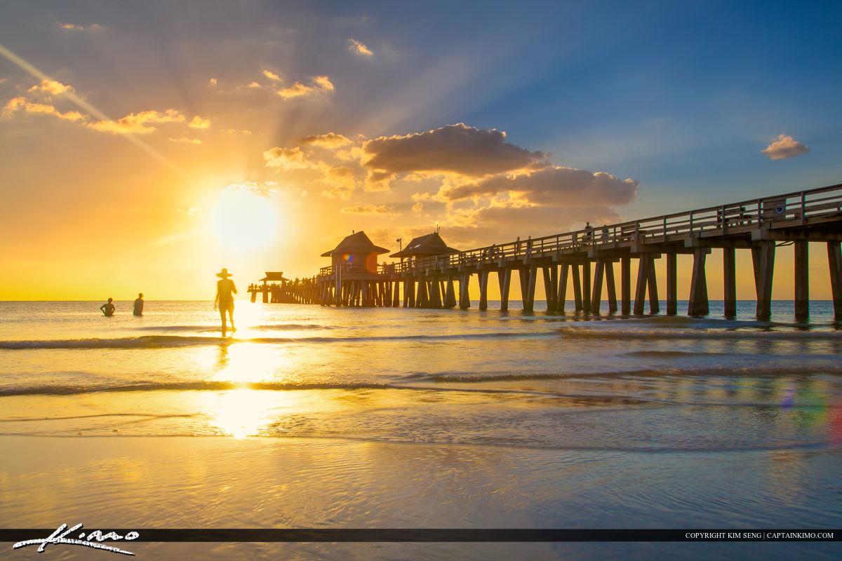 Naples Pier Sunset at Gulf Coast People on Beach
