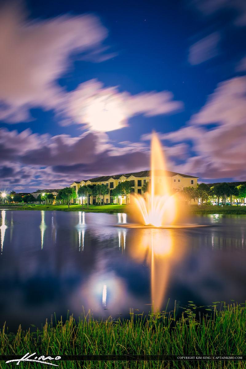 Water Fountain at Neighborhood Lake Under the Moon Light