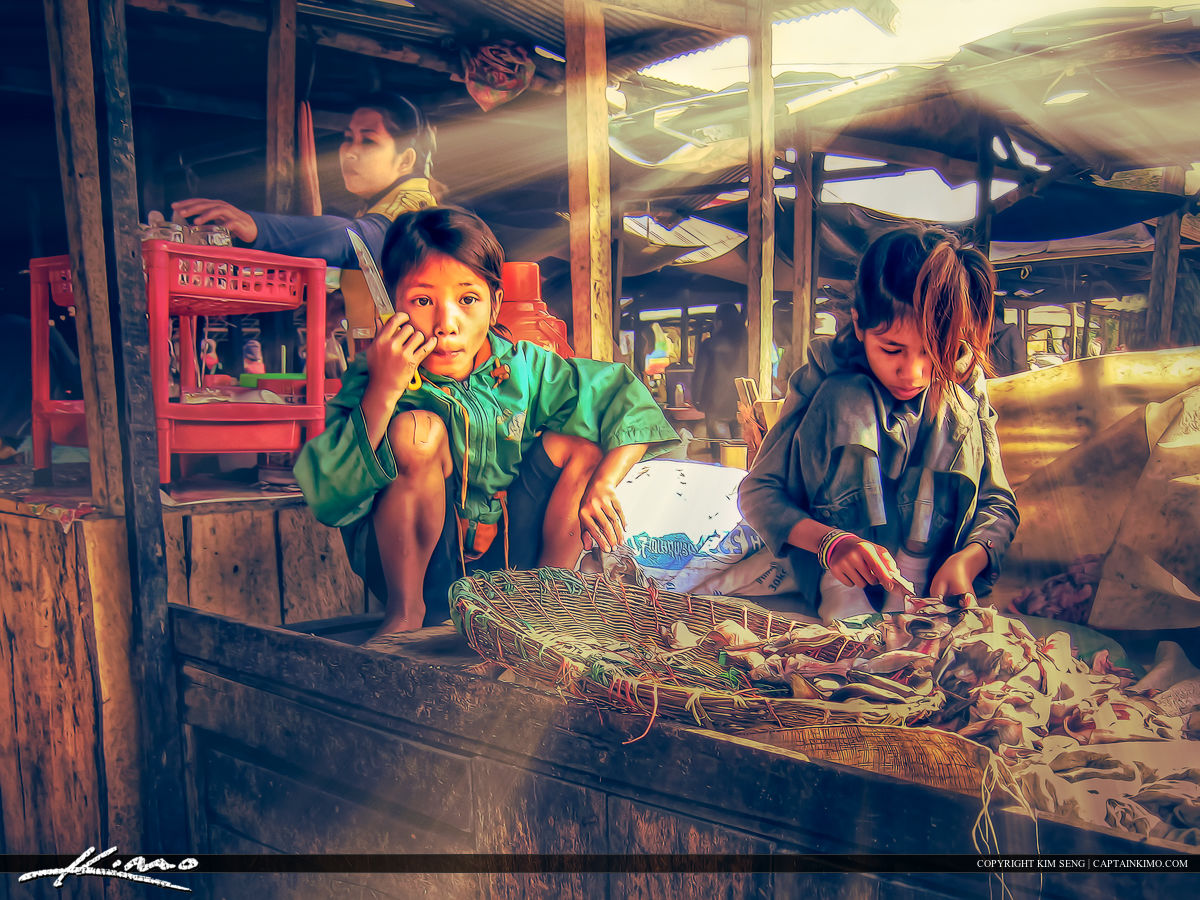 Girls Helping their Mother at the Market in Cambodia