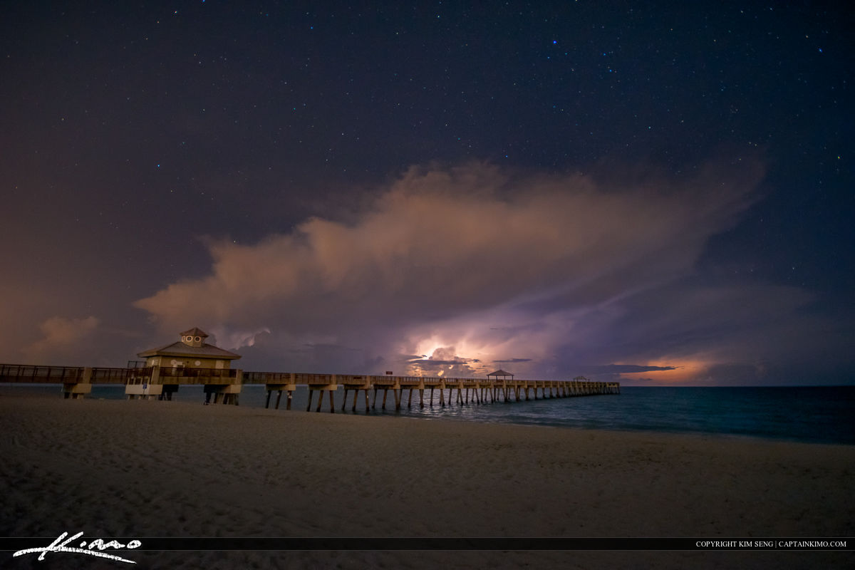 Juno Beach Pier Storm Over Ocean at Night