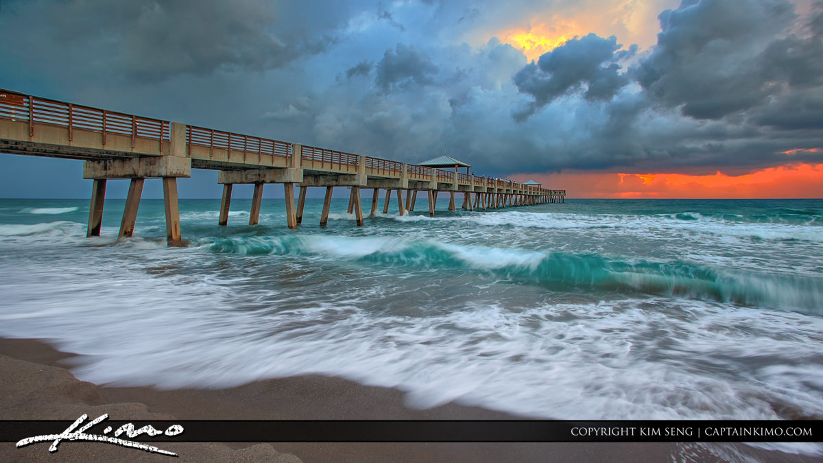 Wave at Juno Beach Pier During Stormy Sunrise