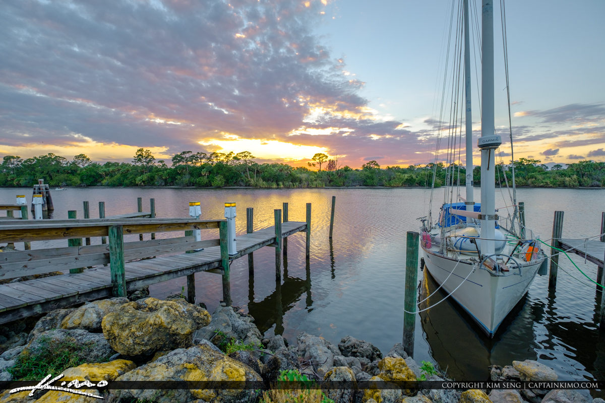 St Lucie Lock and Dam Sailboat with Dock at Sunset