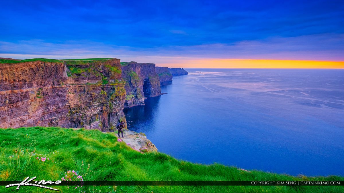Photographer at Cliffs of Moher County Clare Ireland