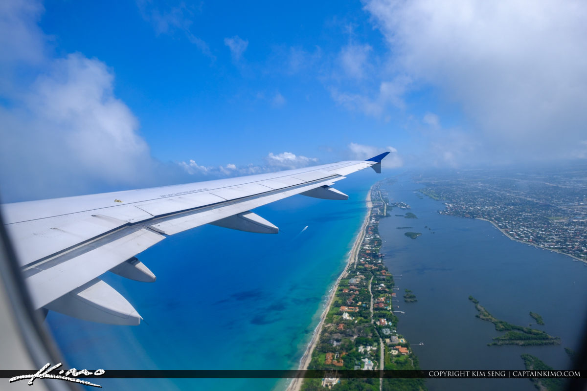 Airplane Wing Take Off Over West Palm Beach Blue Water