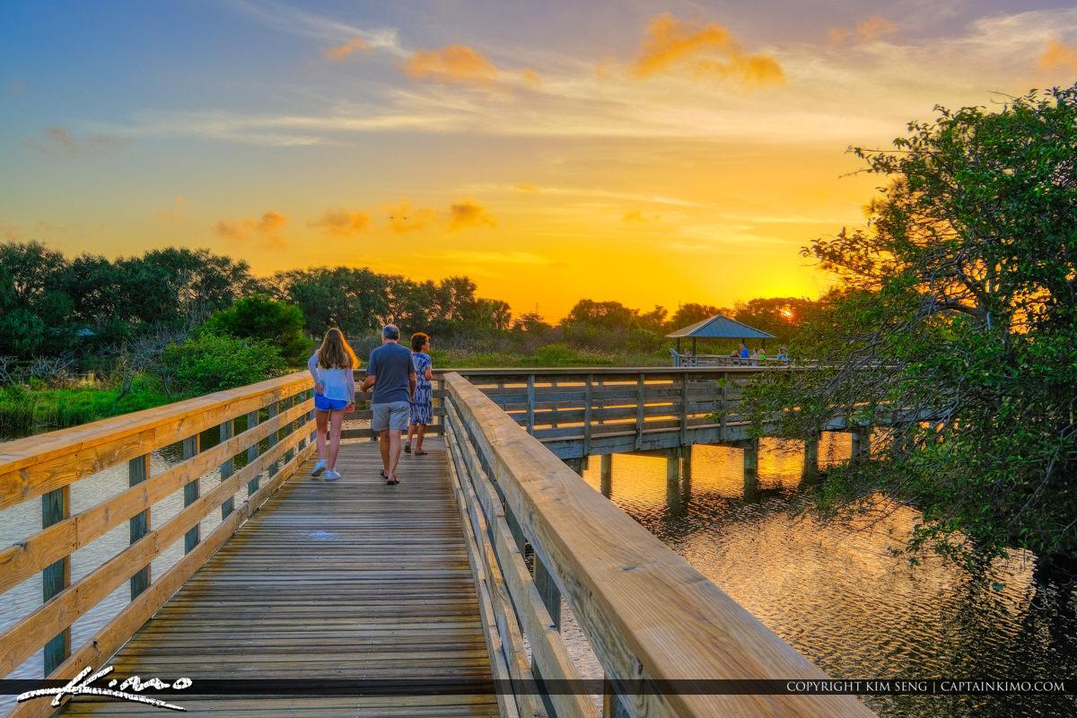 Family Stroll at Boardwalk During Sunset Wakodahatchee Wetlands Delray Beach